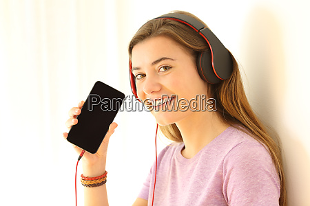 teen listening music and showing a