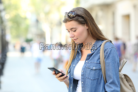 girl checking smart phone content in