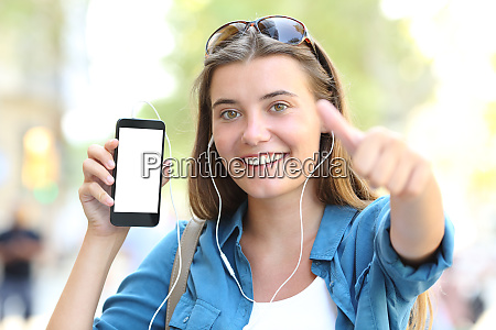 girl listening to music showing blank