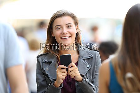 happy girl holding phone and looking