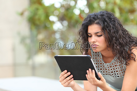 bored woman watching media in a