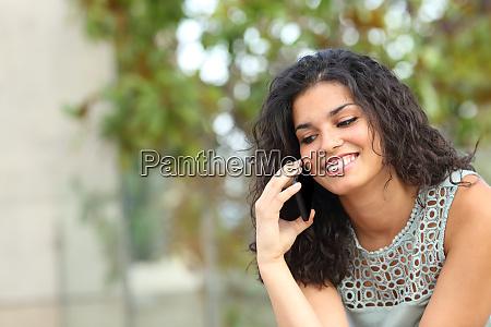 happy lady talking on phone sitting