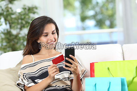 happy online buyer paying with credit