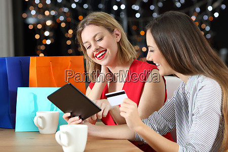 happy friends buying online with credit