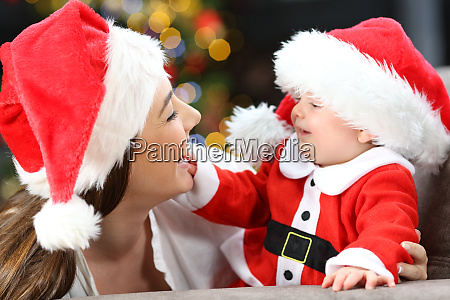 mother and baby playing on christmas
