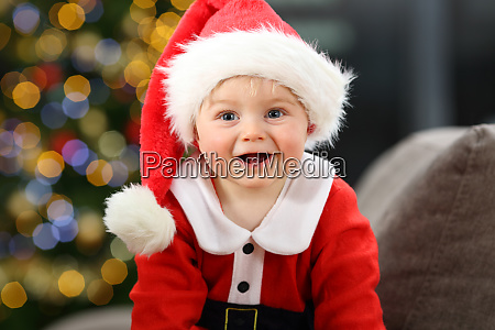 baby dressed as santa in christmas