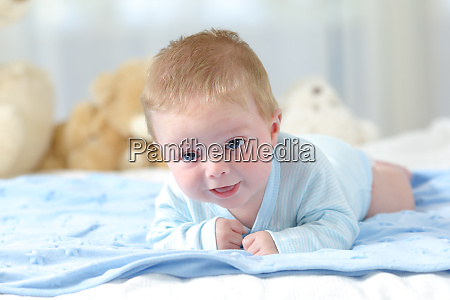 baby on a blue blanket