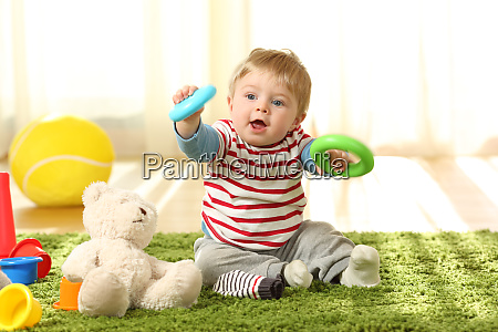 baby playing with toys on a