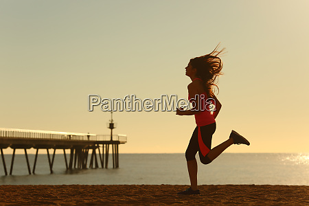 woman running on the beach at