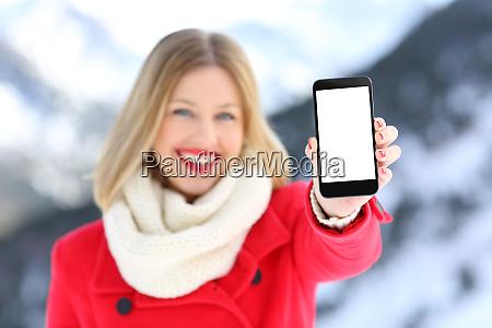 girl showing blank phone screen in
