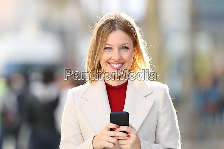 woman posing looking at you holding
