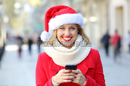 woman holding a phone looking at