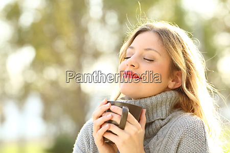 relaxed girl breathing outdoors in winter