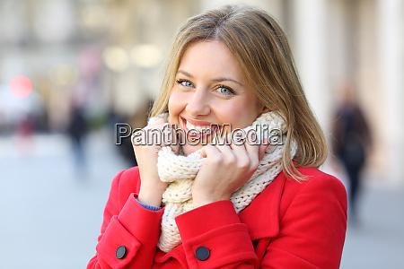 beauty woman keeping warm on the