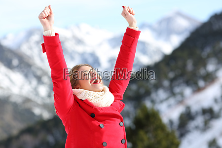 excited woman raising arms in a
