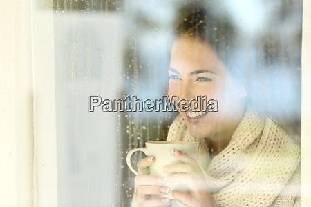 happy lady looking through a window