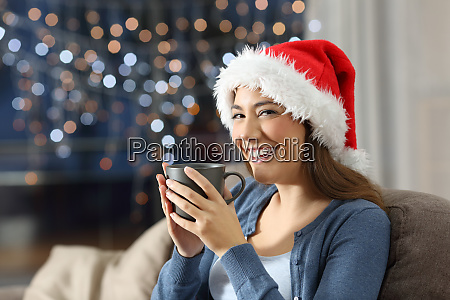 happy woman holding a cup on