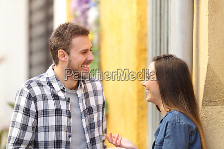 happy couple talking and laughing in