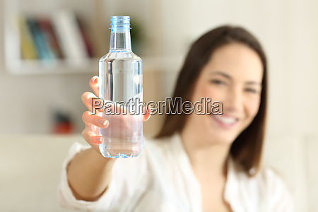 woman showing a bottle of water