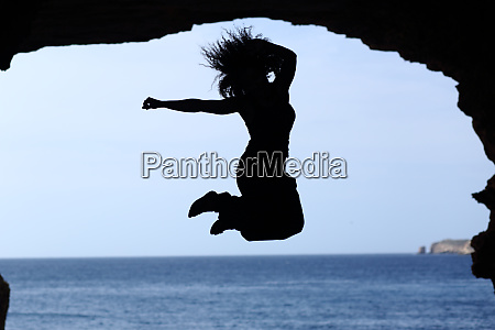 happy woman silhouette jumping on the