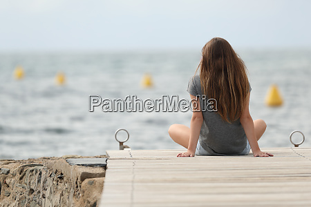 back view of a teen relaxing