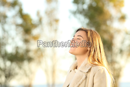 girl breathing fresh air wearing jacket