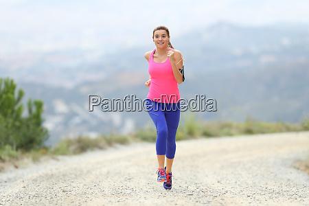 girl running towards camera outdoors