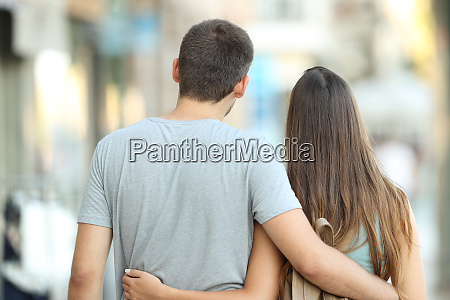 back view of a couple walking