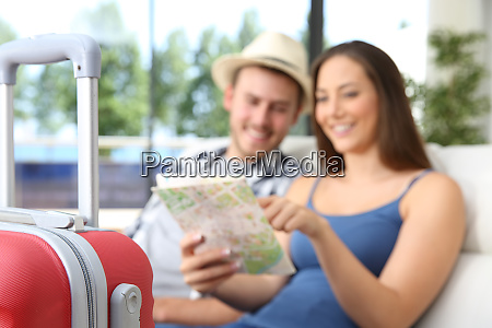 couple of tourists searching location in