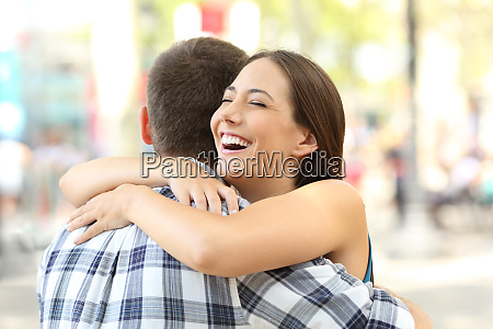 couple or friends hugging after encounter