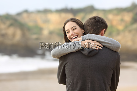 couple of teens hugging on the