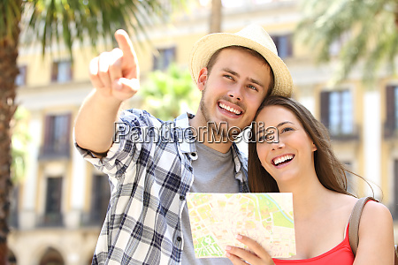 couple of tourists consulting a guide