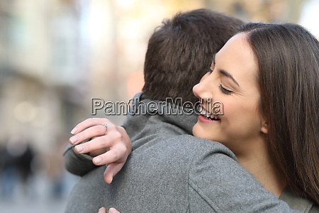 couple hugging after proposal and girlfriend