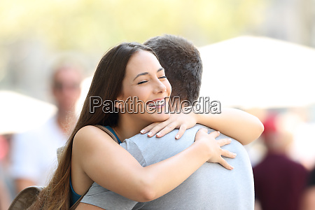 couple hugging on the street after