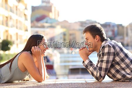 two happy teens falling in love