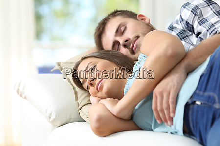couple sleeping in a comfortable couch
