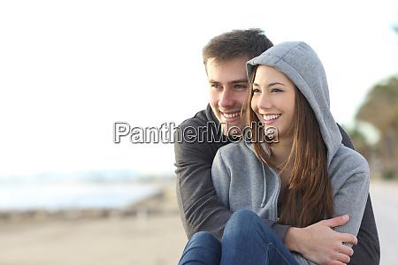 happy teenager couple hugging outdoor