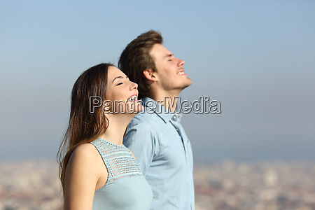 happy couple breathing fresh air with