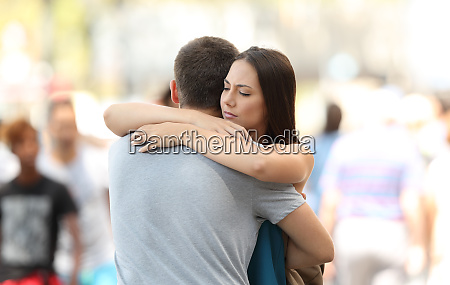 couple with problems hugging on the