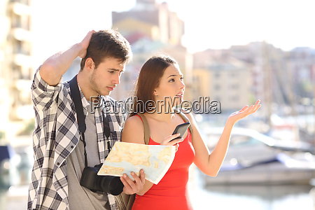 lost tourists searching travel location