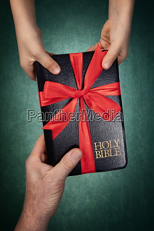 passing the holy bible to the