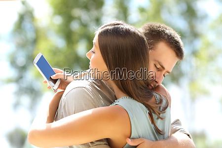 girlfriend cheating and hugging her boyfriend
