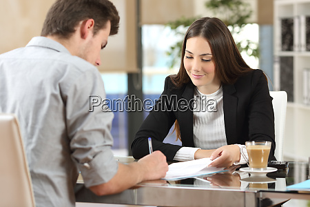 client signing a document in an