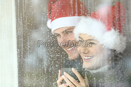 couple looking through a window in