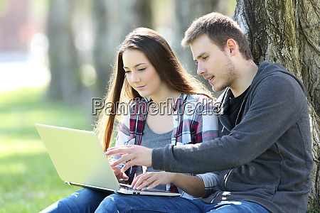 couple of teens searching content online