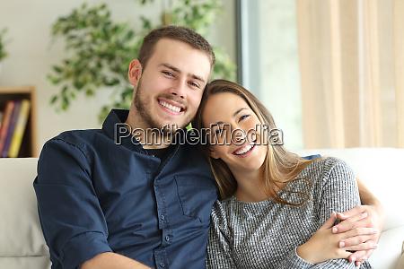 happy couple looking at camera at