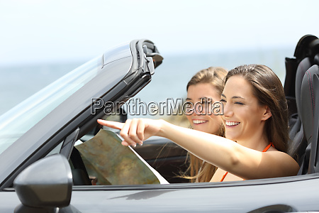 happy tourists in a car consulting