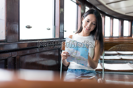 woman using city map and taking