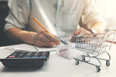 family budget planning man counting