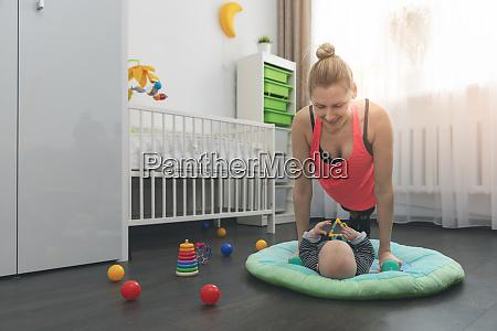 young woman doing push ups at